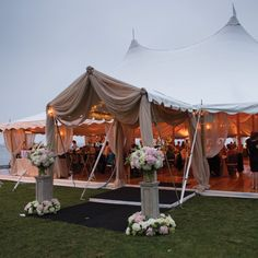 """An outdoor deck was added to the reception tent for a grand entrance. """"the tall lanterns and rope details on the deck added a bit of a nautical touch, which I loved,"""" Meghan says."""
