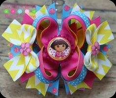 Raspberry Rose Pink Yellow and Turquoise Dora Inspired Boutique Girls Hair Bow with Matching Bottle Cap Center