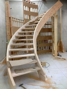 in shop, construction grade curved open riser stair, prefab