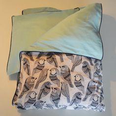 sengetøj med piping