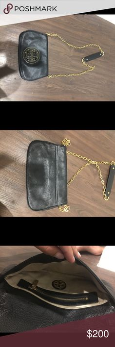 Tory Burch purse Authentic black bag with long gold strap. In great condition! Please submit an offer and we can work something out! Tory Burch Bags Crossbody Bags