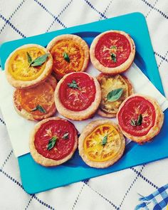 Tomato Tartlets! They are so cute and tiny, and  delicious I'm sure. They will be a perfect savory dish for the baby shower I'm hosting. All of the ingredients are OK for pregnant women to eat (no soft cheeses!)