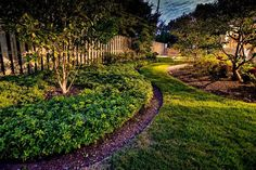Well-defined bed edges complement the meandering grass path in this landscape enhancement by Rine Landscape Group. #housetrends #Columbus https://www.housetrends.com/specialist/Rine-Landscape-Group