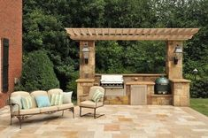 Pergola nicely frames this outdoor cooking area with built-in grill and Big Green Egg. #LandscapingandOutdoorSpaces