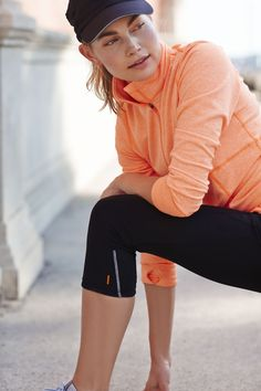 Keep the pace with our half zip pullover in papaya   lucy activewear