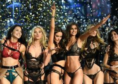 Adriana Lima Photos Photos - Victoria's Secret Angels (fromL) Brazilian model Adriana Lima, British model Lily Donaldson, Brazilian model Alessandra Ambrosio, US model Taylor Hill, US model Martha Hunt and Portuguese model Sara Sampaio cheer during the 2016 Victoria's Secret Fashion Show at the Grand Palais in Paris on November 30, 2016.  / AFP / Martin BUREAU / RESTRICTED TO EDITORIAL USE - 2016 Victoria's Secret Fashion Show in Paris - Show