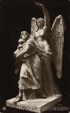 Statue of Angel Protecting a Mother and Child Angels