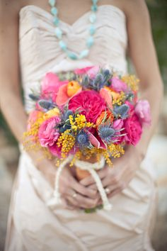 I've never seen thistles used in a bouquet. Beautiful and sculptural!