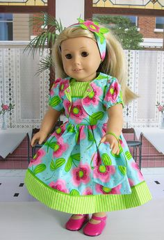 Sweet sleeveless dress in a fun watermelon flower in pink on a turquoise background. Contrast green and lime green stripes compose the bottom skirt band and the bodice top. Dress is embellished with a green grosgrain ribbon.