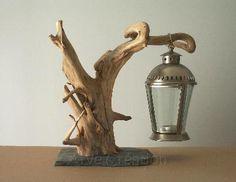 Arve Création  galets et bois flotté : support lanterne