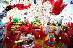 Chinese folk artists perform the lion dance at a temple fair to celebrate the Lunar New Year on January 22, 2012 in Beijing. Also known as the Spring Festival, which is based on the Lunisolar calendar, it is celebrated from the first day of the first month of the lunar year and ends with the Lantern Festival on the Fifteenth day. (Feng Li/Getty Images)