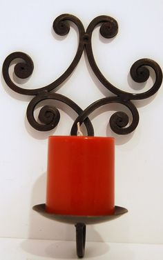 Vintage Hand Fabricated Iron Wall Sconce Candle Holder Rusty Rustic Scroll Work Industrial Metal. $14.99, via Etsy.