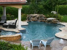 Be inspired by nature when you design your pool. A natural rock waterfall and an elevated pedestal spa are at the opposite ends of this lagoon-style pool by Pool Builders Inc. Photo courtesy of Digital Wave Productions