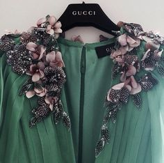 Love the embellishment but not the green.