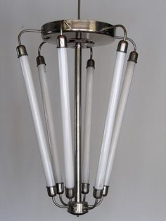 This large lobby lamp was designed and manufactured in Germany around 1940 in a modernist Bauhaus style. It features six fluorescent tubes. The chrome has signs of wear and the electrics have been renewed so the lamp is ready to use. The height of 84 cm is without suspension.