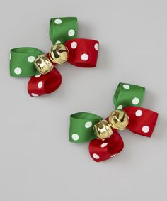 Add some festive fun to a darling's hair with the joyous jingle of this pair of bows. Featuring jolly colors and two bells on each, cuties will cast a delightful tune with each twirl.Includes two bows3'' W x 2.5'' HGrosgrain ribbon / metalSpot clean...