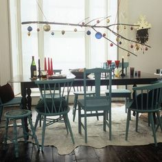 Google Image Result for http://4.bp.blogspot.com/_cvQ0O6DvUyw/TPQNBrI13VI/AAAAAAAAGdc/lKMON0FwQPs/s1600/fun-cheerful-christmas-decoration-baubles-on-branch-hanging-over-dining-table-unique-way-to-decorate-suspended-decor-idea-project.jpg