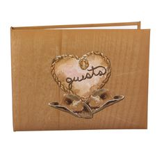 """Country Flair Wedding Guest Book designed to look like wood grain. In the middle sits a heart framed with rope that reads """"guests"""". Two matching cowboy hats sit below the heart."""