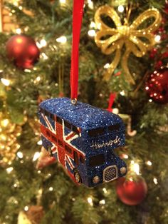 Union Jack London bus ornament from Harrods London Christmas, Winter Christmas, Christmas Holidays, Xmas, Harrods Christmas, Merry Christmas, Christmas Ideas, Christmas Tree Ornaments, Christmas Decorations