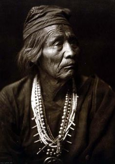 You are looking at a beautiful picture of Nesjaja Hatali - a Navajo Medicine Man. It was created in 1904 by Edward S. Curtis.    The picture presents Nesjaja Hatali, medicine man, head-and-shoulders portrait, facing right.    We have created this collection of illustrations primarily to serve as a valuable educational tool. Contact mailto:curator@ol....