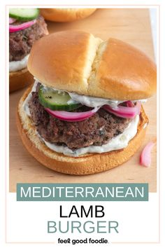 Simple and quick to make, these juicy lamb burgers are one tasty bite! Seasoned with mint, cumin and cinnamon before being grilled, and served on buns with tzatziki, pickled onions and cucumber. This is one burger that is loaded with flavor. Lamb Burger Recipes, Lamb Patties, How To Cook Burgers, Lamb Burgers, Grilled Lamb, Ground Lamb, Pickled Onions, Tasty Bites, Tzatziki