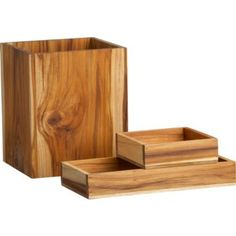 I can see a few of these teak boxes stacked up on the bath counter housing a milk-glass hand soap container + a few rolled cloth's.