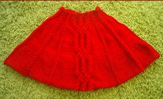 Knitting pattern for a ladies 8ply cabled cape.