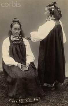 Two Norwegian girls wearing traditional costumes.