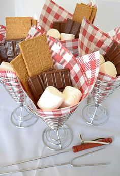 A Fun Way to Serve Up S'mores: No Fourth of July party is complete without s'mores. Serve them up in french fry holders and festive paper cones. Once sundown hits, you can just light the campfire and pass out your pre-prepped s'mores fixings.
