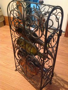 Check out this item in my Etsy shop https://www.etsy.com/listing/240509744/vintage-wrought-iron-wine-rack5-bottles