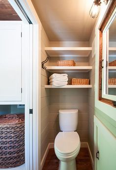 The bathroom is pristine in mostly white, apart of a tiny home in Guntersville, Alabama.