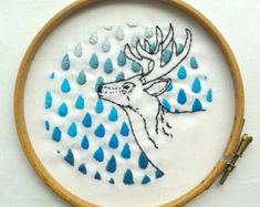 Embroidery art. Deer and spring leaves. Modern hand embroidered home decor…