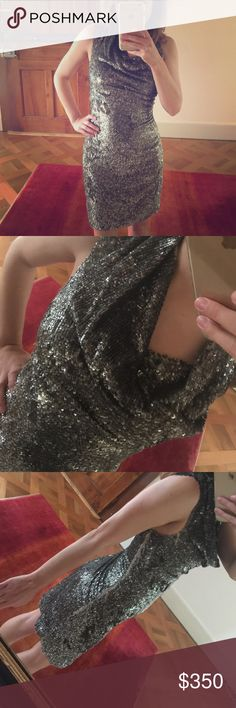 "All Saints sexy dark silver sequin cocktail dress This amazing All Saints Spitalfields is a unique find - sexy but deconstructed, fashion forward style. Purchased at Harrod's in London and wore three times for special occasions. Size UK6 - model is 5'2"", 110 lbs., 32C and it fits like a glove, a tiny bit tighter than I would like. Measures 34"" long. FLAWLESS - this is meant to have a ""deconstructed"" look so there some areas where the sequins aren't perfect and thread are loose but it's…"