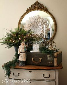 Christmas decor with greenery, paper wreath and antique trunk