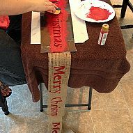 "DIY Burlap Garland. 300 feet of 4"" wide burlap for under $10 and stencil your own holiday saying."