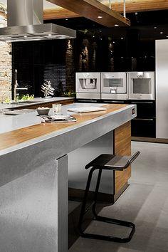 Needing spot for laptop action in Kitchen. Super stylish kitchen! Gaggenau
