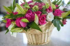 Flower basket arrangement by Miya's Elegant Designs