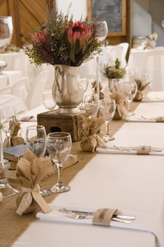 Shabby chic, vintage wedding reception. Burlap, hessian runners and wooden boxes - Kilcairn