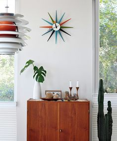 Love the bright colours of the Vitra sunburst clock (http://www.cimmermann.co.uk/product/vitra_sunburst_clock_multicoloured/)