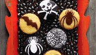 Make a bevy of bats, a swarm of spiders, or an assortment of other scary designs atop chocolate cupcakes.