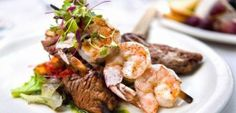 End your day with a delicious dining experience at one of our open-air gourmet restaurants. Whatever your idea of the perfect day, Hacienda . Seafood Company, Beef Skewers, Food Festival, Food Preparation, Shrimp, Low Carb, Menu, Dining, Catering Companies