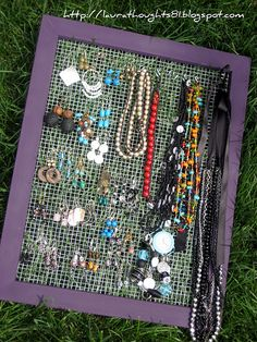 Oooh, I'm going to make this too! Jewelry holder out of a cheap frame and wire mesh with S hooks to hold the necklaces