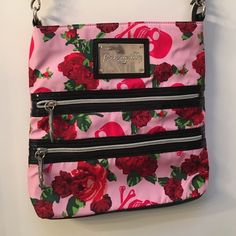 Betsy Johnson messenger bag/ purse Rose and skull print Betsy Johnson messenger bag. Pale pink background, hot pink skull and crossbones and red rose print. Gently used. Please make me an offer!!!☘ Betsey Johnson Bags Satchels
