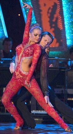Red Lace Catsuit worn By Ola Jordan. Click Here To Buy your Catsuits from DCUK.