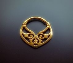 This unique handmade septum ring is 14k solid gold.