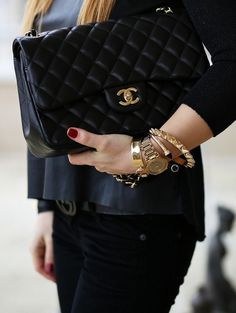 classic quilted black Chanel + gold arm party