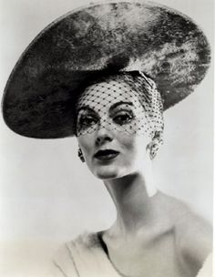 Publicity photo, 1950s, for Mr. John Collection, modelled by Carmen Dell'Orefice