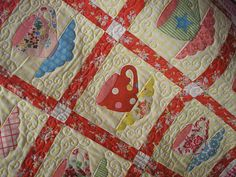Great quilting design on this quilt. It totally reminds me of steam coming off of a hot cup of tea.