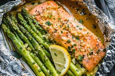Salmon and Asparagus Foil Packs with Garlic Lemon Butter Sauce - - Whip up something quick and delicious tonight! - by recipes on stove top Salmon and Asparagus Foil Packs with Garlic Lemon Butter Sauce Baked Salmon And Asparagus, Oven Baked Salmon, Asparagus Recipe, Keto Salmon, Wild Salmon Recipe Baked, Baking Salmon In Oven, Recipes With Asparagus, Lemon Pepper Salmon, Best Salmon Recipe