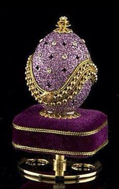 Glittering lavender coats this authentic egg, which rests atop a pedestal covered with royal purple velvet. Star-shaped designs are cut into the egg shell, alternating with sparkling clear crystals. Golden beads and braid edge the lid, which opens to disp Purple Velvet, Purple Gold, Lilac, Objets Antiques, Fabrege Eggs, Egg Art, All Things Purple, Russian Art, Glass Art